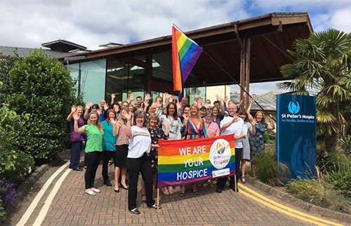 St Peter's Hospice staff members with the Pride flag